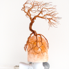 himalayan salt lamp with copper tree